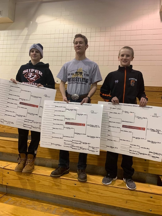 Avery Leonard, Logan Kantor, and TJ O'Connor pictured with winning placards.