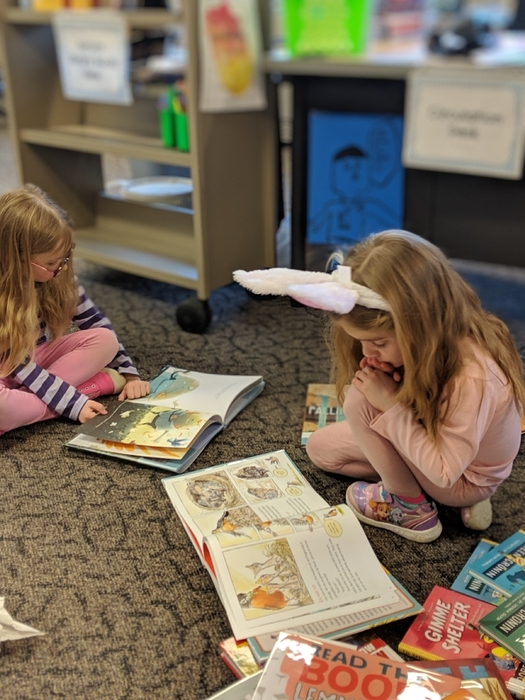 Madalyn and Gabby read among the new books.