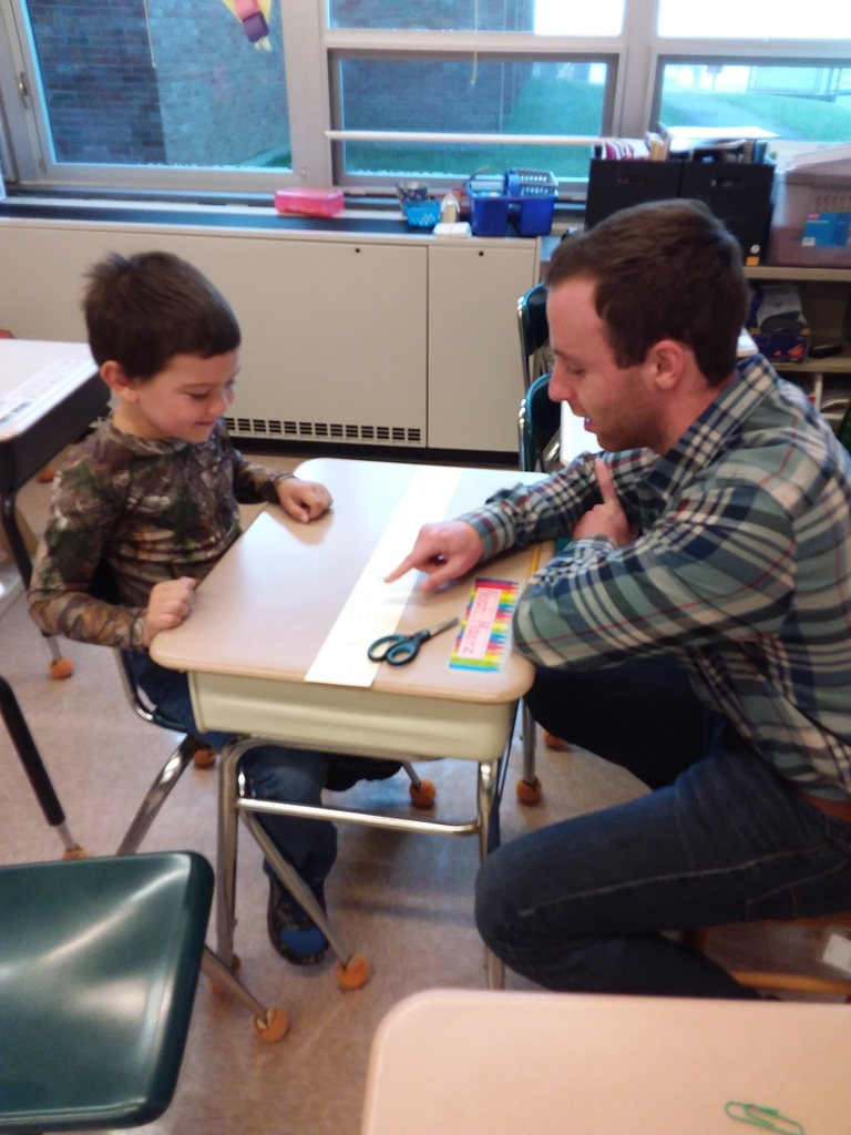 First grader Noah works with Mr. Greenberg, Mrs. West-Arnot's student teacher.